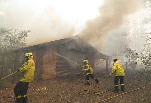 Bush fire destroys house